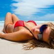 Stock Photo: Attractive girl is lying on the beach