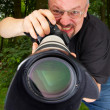 Photographer with telescopic lens. — Stock Photo