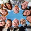 Happy team. On blue sky — Stock Photo #1393454