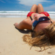 Attractive girl is lying on the beach — Stock Photo #1393626