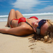 Girl is lying on the beach — Stock Photo #1393638