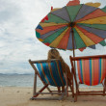 Single girl on empty beach — Stock Photo #1393775
