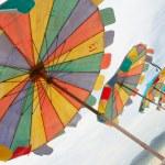 Multi coloured happy parasols — Stock Photo #1393778
