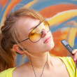 Girl with mp3-player — Stock Photo
