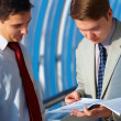 Two business men is watching report — Stock Photo