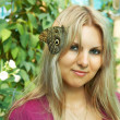 Cute girl with butterfly — Stock Photo #1398473