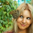 Cute girl with butterfly — Stock Photo