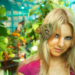 Cute girl with butterfly — Stock Photo #1398508