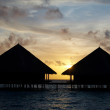 Two Water Villas in The Ocean. - Stock Photo