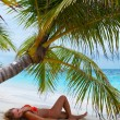 Cute Girl is relaxing on the beach. — Stock Photo