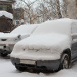Stock Photo: Cars under snowdrift.