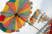Multi coloured happy parasols — Stock Photo