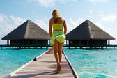 Water Villas and sexy Lady. — Stock Photo