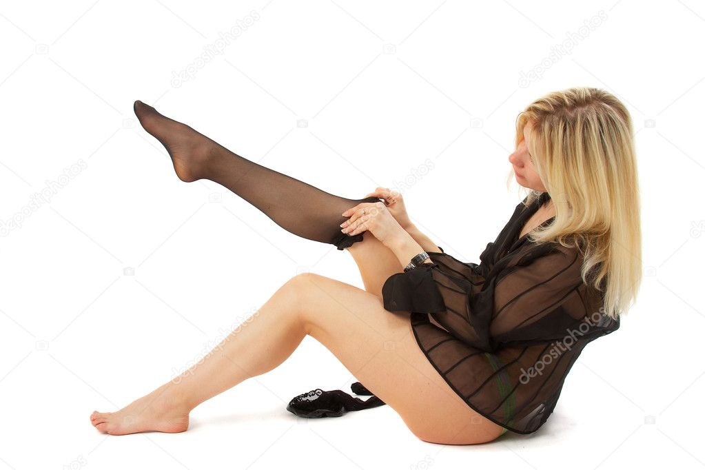 Girl is putting on stocking. Full isolated. See portfolio for more... — Stockfoto #1398374