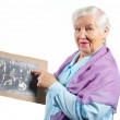 Grandmother with old family photo. - Stock Photo