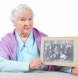 Royalty-Free Stock Photo: Grandmother with old family photo.