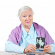 Grandmother with old family photos. — Stock Photo #1400629