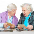 Two grandmothers with old photos. — Stock Photo