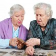 Stock Photo: Two grandmothers with old photos.