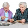 Two grandmothers with old photos. - Stock Photo