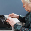Royalty-Free Stock Photo: Grandmother with antique typewriter
