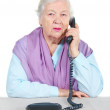 图库照片: Grandmother is calling by phone.