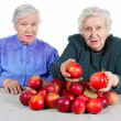 Two Grandma with red apples. — Stock Photo