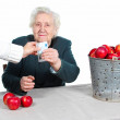 Grandma sold red apples — Stock Photo