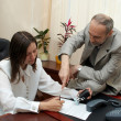 Stockfoto: In Office. Female sign a treaty.