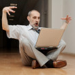 Royalty-Free Stock Photo: Director sitting on the floor, emotions!