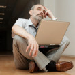 Man sitting on the floor and thinking — Stock Photo #1401456