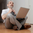 Man sitting on the floor and thinking — Stock Photo