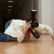 Spy Paparazzo grabbling - Stock Photo