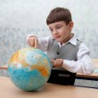 Elementary school. Schoolboy with globe — Stock Photo