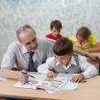 Elementary school. Teacher and children - Stock Photo
