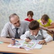 Foto Stock: Elementary school. Teacher and children