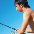 Royalty-Free Stock Photo: Fisherman is fishing