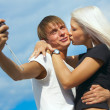 Happy couple is taking a picture — Stockfoto