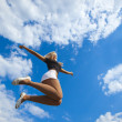 Jumping on blue sky — Stock Photo