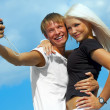 Happy couple is taking a picture — Foto de Stock