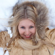 Winter girl is lying on snow — Stock Photo