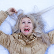 Crazy Winter girl is lying on snow — Stock Photo