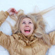 Crazy Winter girl is lying on snow — Stock Photo #1407048