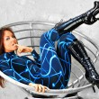 Futuristic girl in fashion chair — Stock Photo