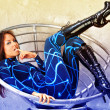 Futuristic girl in fashion chair. — Stock Photo
