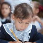 Schoolgirl is writing exercise — Stock Photo