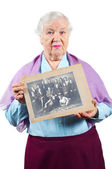 Grandmother with old family photo. — 图库照片