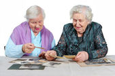 Two grandmothers with old photos. — Stockfoto
