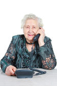 Grandmother is calling by phone. — Stock Photo