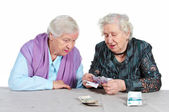 Two Grandma is counting Russian money. — Stock Photo